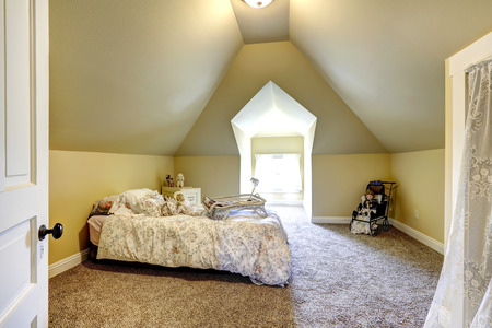 vaulted ceiling: Soft ivory bedroom with brown soft carpet and vaulted ceiling  Furnished with single bed and decorated with dalls