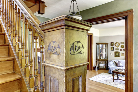 Old staircase with close up view of wooden carved pole photo