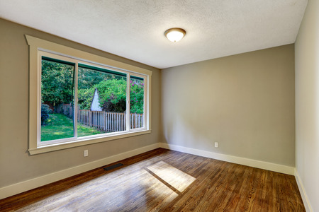 hardwood: Empty bright room with hardwood floor and wide window. Stock Photo