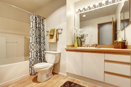 Soft creamy bathroom interior with bathroom vanity cabinet with mirror