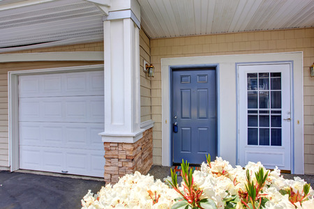 Residential building entrance porch with two entrance  doors