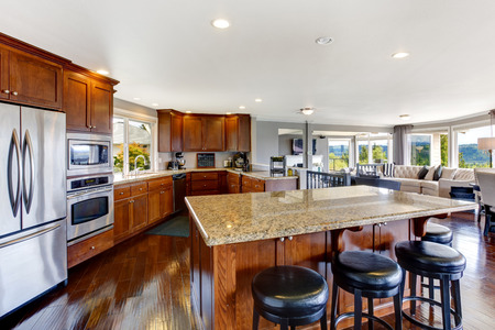 kitchen island: Spacious luxury kitchen room interior with kitchen island and black stools