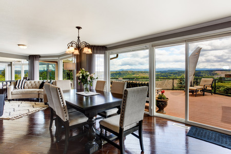 northwest: Elegant dining area with walkout deck in luxury house  Stock Photo