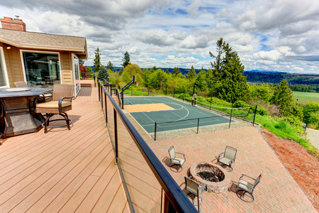 screened: Screened walkout deck with tennis court and patio area view
