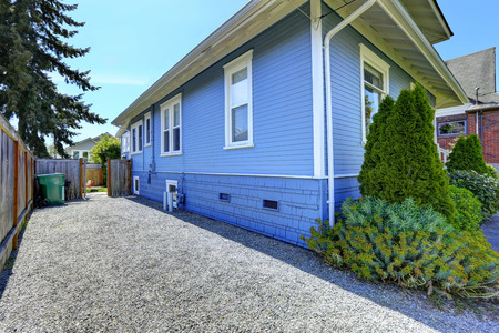 fenced: House exterior in light blue. View of fenced backyard