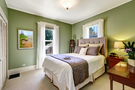 nightstand: Light green elegant bedroom interior with beautiful bed and nightstand