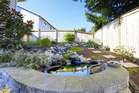 Home garden with decorative pond and landscape