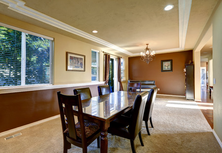 Ivory and brown dining room  with piano and dinin table set photo