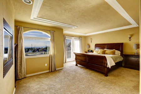 nightstands: Spacious bedroom with queen size bed and nightstands in luxury house