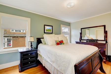 queen bed: Bedroom interior with vanity cabinet and queen size bed