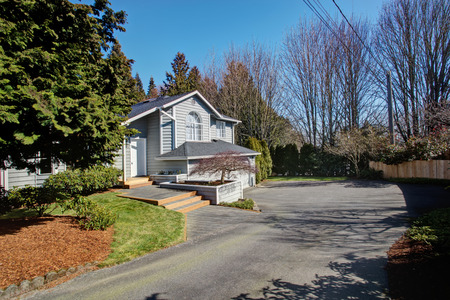 garage on house: House with entrance porch and garage. View from driveway Stock Photo