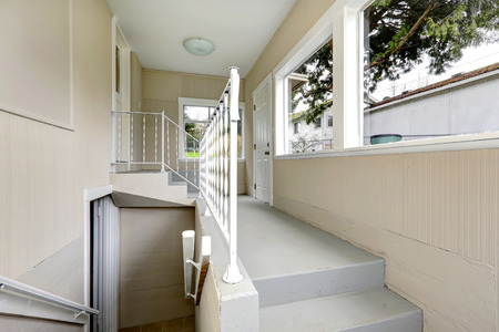 Bright hallway with stairs to basement. photo
