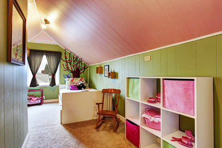 idea comfortable: Kids room with vaulted ceiling in contrast green and pink colors Stock Photo