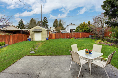 furniture design: Fenced backyard with small patio area and shed Stock Photo