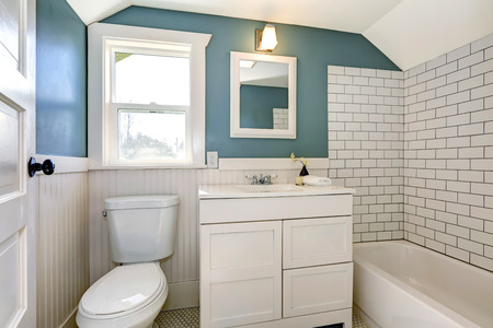 white trim: Bathroom interior with tile and plank wall trim Stock Photo