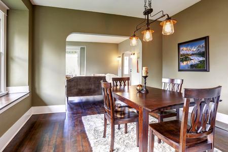 open floor plan: Open floor plan. Dining area with dark brown dining table set and soft rug on hardwood floor