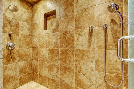 bathroom wall: Granite tile wall trim in luxury bathroom
