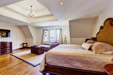 queen bed: Luxury bedroom with design interior. Furnished with queen bed, sofa, chest and tv