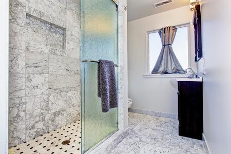 bathroom wall: Bathroom with granite tile floor and granite tile wall trim in luxury house