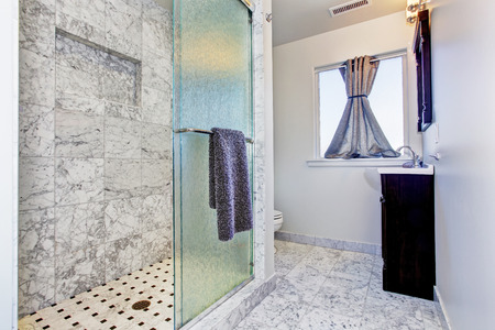 Bathroom with granite tile floor and granite tile wall trim in luxury house photo