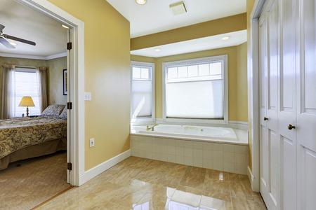 shiny floor: Soft tones bathroom with windows and shiny tile floor