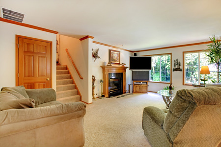open floor plan: Large bright traditional living room.