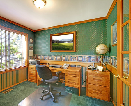 office furniture: Green wallpaper and traditional furniture home office.