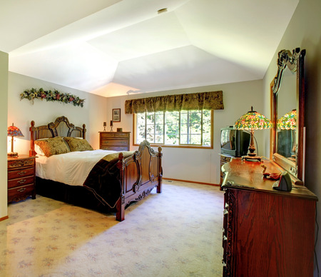 master bedroom: Large green walls traditional American master bedroom.