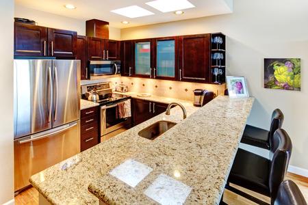 refrigerator kitchen: Fanctional small but luxury modern kitchen with dark brown cabinets.