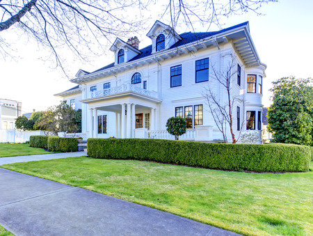 trimmed: Luxury american house with column porch and curb appeal