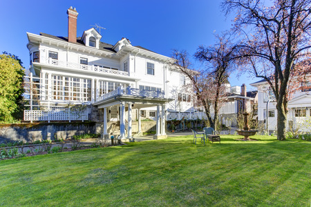 Large luxury house with column walkout deck and garden photo