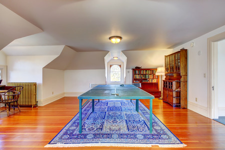 vaulted: Entertainment room with vaulted ceiling and hardwood floor. View of tennis table