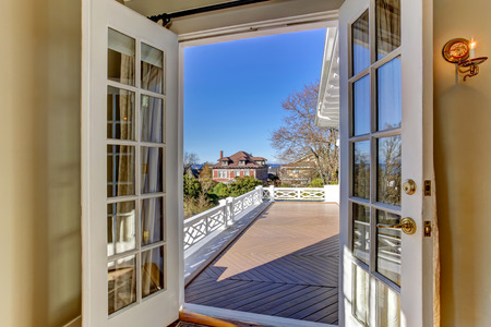 white trim: Open french door to walkout deck Stock Photo