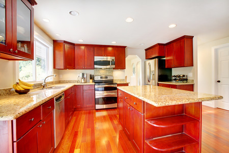 granite kitchen: Bright red kitchen room with granite tops and kitchen island