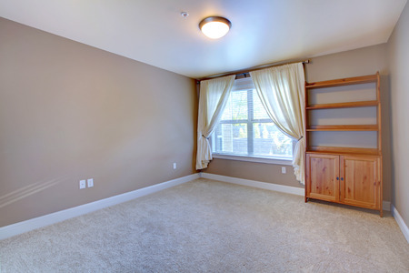 empty: Empty room interior with soft carpet and cabinet in corner Stock Photo