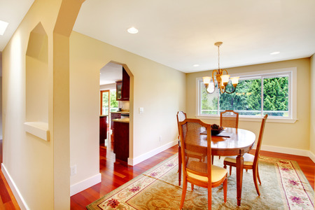 Bright dining room with wooden table set. photo