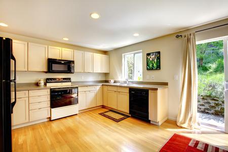 black appliances: Kitchen interior with black appliances and hardwood floor