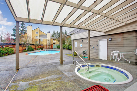 Backyard with jacuzzi and swimming pool photo