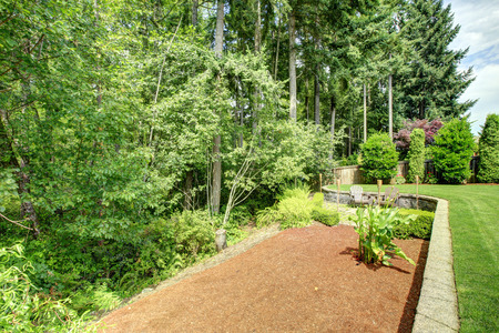 flower bed: Backayrd landscape design with lawn and flower bed Stock Photo