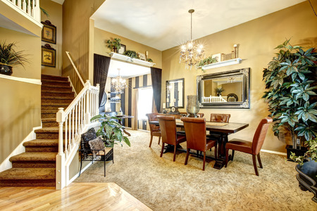 open floor plan: House with open floor plan. View of dining table  and wine tasting area Stock Photo