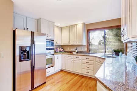 kitchen cabinets: Elegant kitchen with white storage cabinets and granite tops Stock Photo