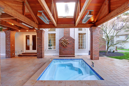 Large walkout deck with brick columns and jacuzzi. photo