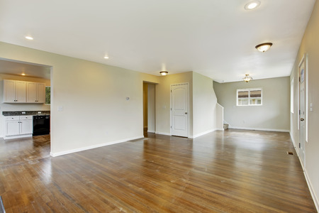 open floor plan: Interior in empty house  with open floor plan. Spacious living room with hardwood floor
