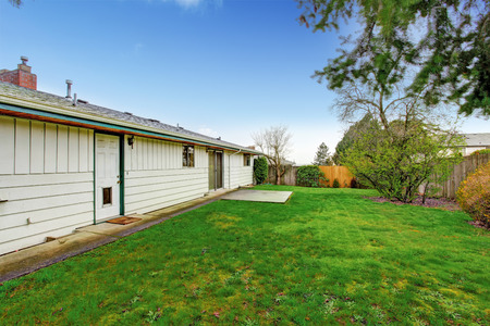 fenced: Fenced backyard with small walkout deck