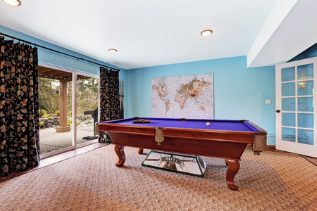 snooker room: Entertainment room with pool table and walkout deck