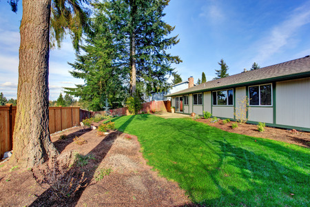 fenced: Fenced backyard with walkout deck Stock Photo