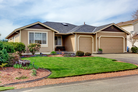 garage on house: House with curb appeal  View of entrance porch, garage with driveway and flower bed