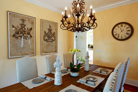 designer chair: Served dining table with flower and statues Stock Photo