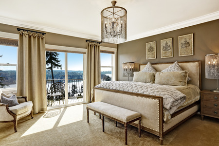 luxury bedroom: Luxury bedroom interior with rich furniture and scenic view from walkout deck