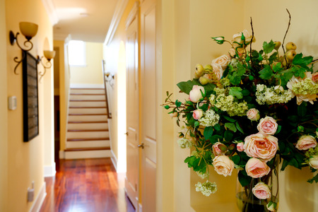 Hallway in luxury house decorated with rose buquet photo